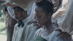 "Nate Parker as ""Nat Turner"" and Aja Naomi King as ""Cherry"" in THE BIRTH OF A NATION. Photo courtesy of Fox Searchlight Pictures. © 2016 Twentieth Century Fox Film Corporation All Rights Reserved"