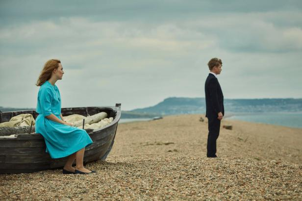 "This image released by Bleecker Street shows Saoirse Ronan, left, and Billy Howle in a scene from ""On Chesil Beach."" (Bleecker Street via AP)"